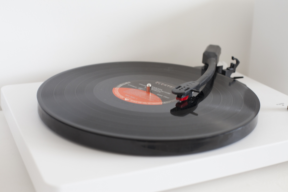 Record playing on a white victrola record player