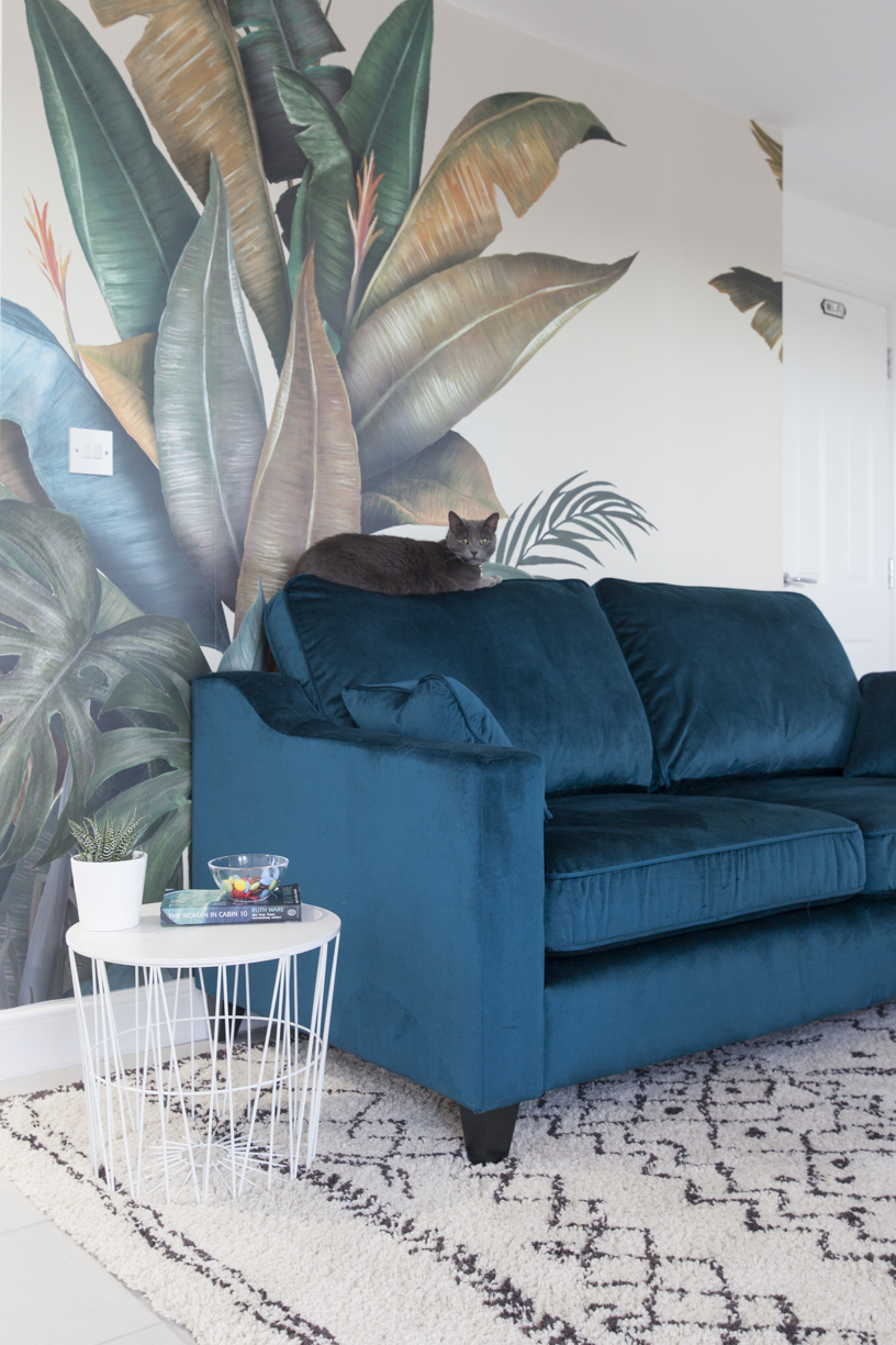 PhotoWall Leaf Print TROPICAL with velvet teal sofa