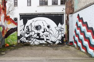 Sheffield Street Art black and white Skull on a brick wall