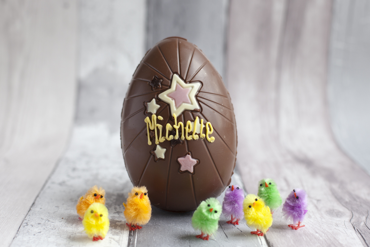 Thorntons hollow chocolate Easter Egg with mini fluffy spring chicks with stars