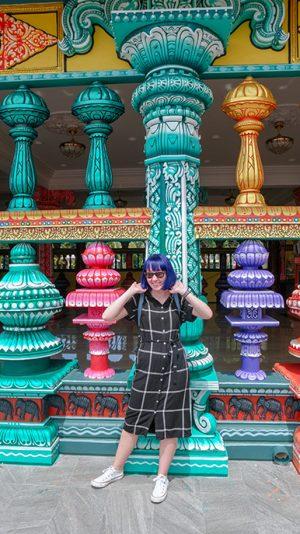 Batu Caves Kuala Lumpur girl stood in front of temple entrance