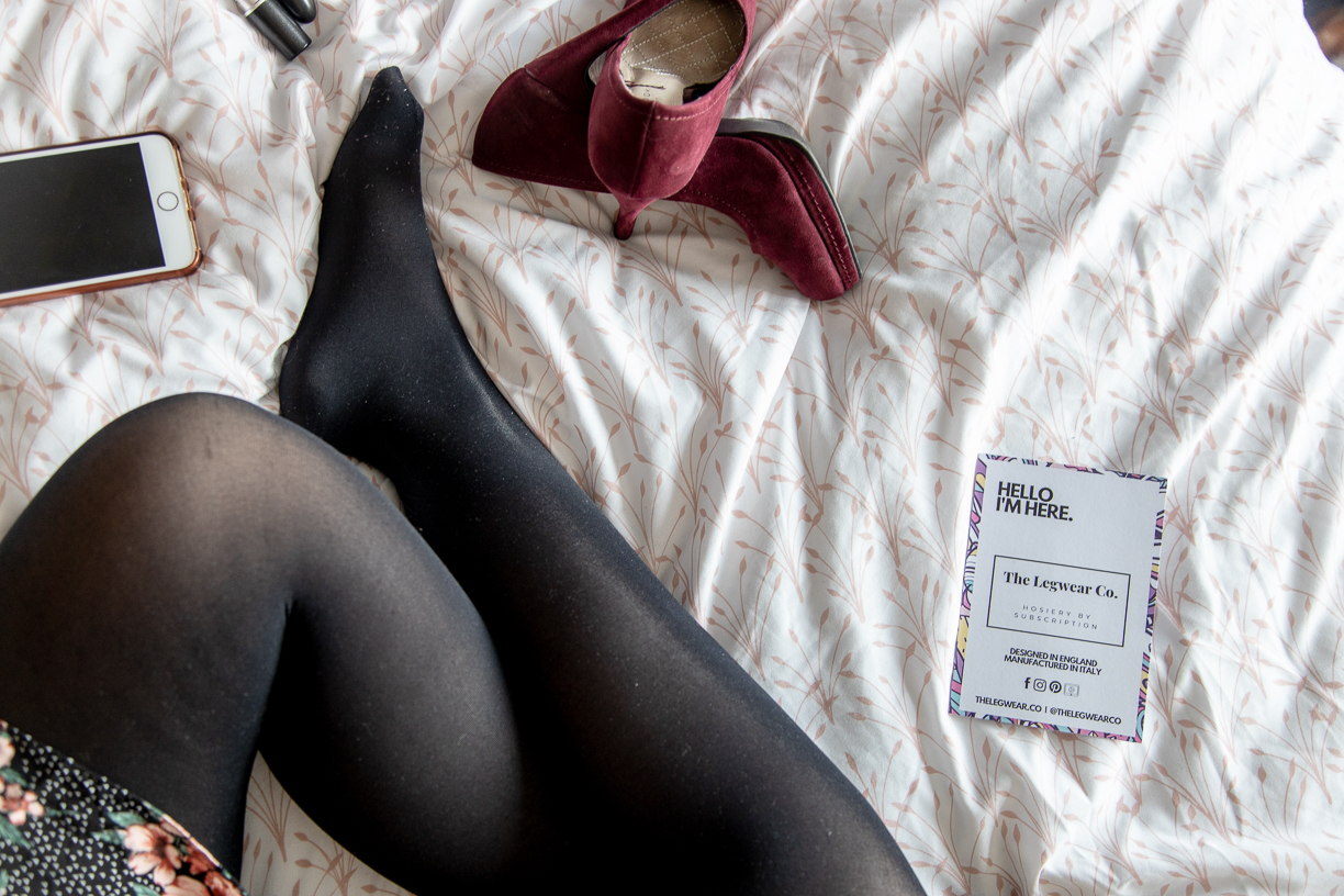 women in tights on a bed with shoes. The legwear company