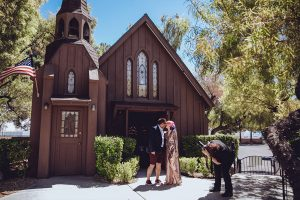 Glamours couple outside the little chapel of the west Las Vegas